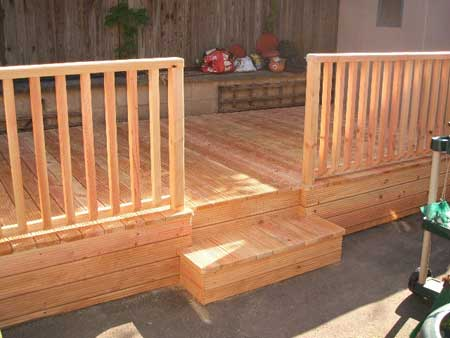 Decking with balustrades  made from natural cedar wood